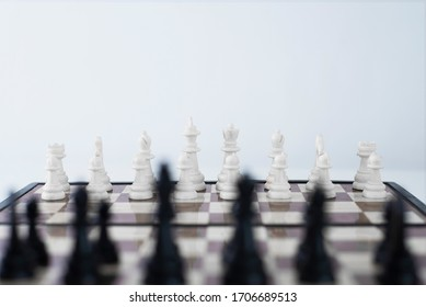Chess board game on start. Best successful business strategy. Plan competition leader concept strategy. Copy space for your text. White pieces go first, waiting for the first step.