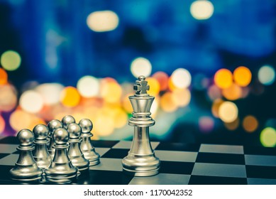 Chess board game to represent the business strategy with competition in the world market. and find out the best solution to meet target objective and goal. Sign and symbol of challenging as concept.