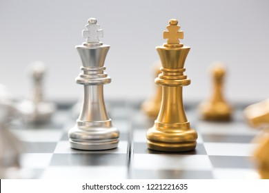Chess board game,silver chess teame and gold chess team,  ideas for business, leadership, teamwork and plan concept.