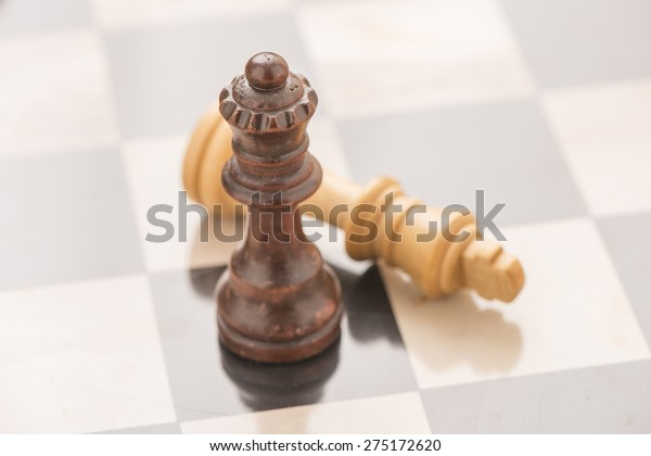 Chess board and pieces. Black queen. Conceptual image of strategy, competition and success.