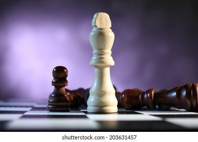 Chess board with chess pieces on purple background
