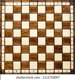 Chess board. Wooden chess board. Chess board background. Chessboard brown pattern.