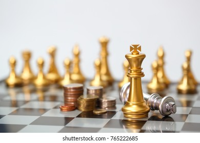 Chess business with coins idea for competition, success and leadership concept (business using as background)