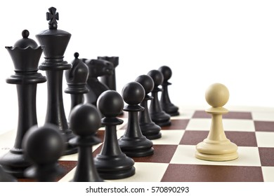 Chess business concept, leader & success. White pawn in front of black figures on chess board
