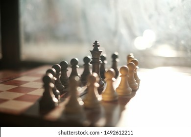 The chess by plastic. All Black and White Pawn with Black king in Chess Chess is a two-player strategy board game played on a checkered board with 64 squares arranged in an 8×8 grid.