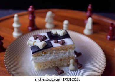 Chess cake with white chocolate and milk chocolate chess pieces