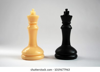 Chess figure, business concept strategy, leadership, team and success.Chess game player makes a move the white pawn one step forward.Pair of king chess peaces confronted as opposites.
