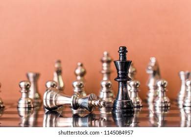 Chess figure in competition success play. strategy, management or leadership