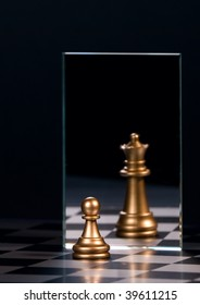 Chess figure and mirror on a black background