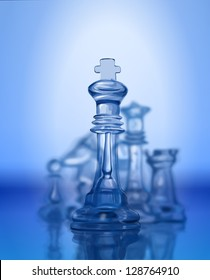Chess figures, led by King on a blue background. Bitmap copy my vector