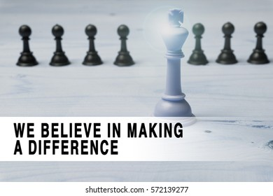 Chess with flare and text We Believe in Making a Difference.