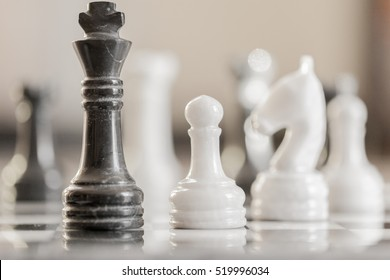 Chess game. Conceptual image depicting making a strategic move with a hand moving a chess piece on a chessboard during a game.