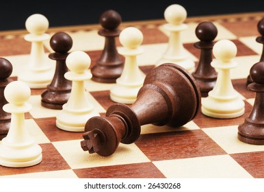 Chess game - Fallen king and pawns