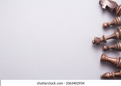 Chess game figures on grey background , top view, flat lay copy space