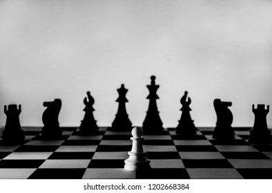 Chess game with good and bad. subliminal message for warrior and peaceful. Pawn alone against others