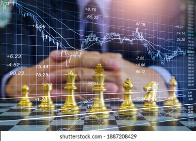 Chess game on chess board behind business man background. Business concept to present financial information and marketing strategy analysis. Investment target in global economy and digital commercial. - Shutterstock ID 1887208429