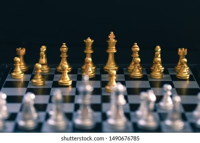 Chess game, set the board waiting to play in both gold and silver pieces detail art