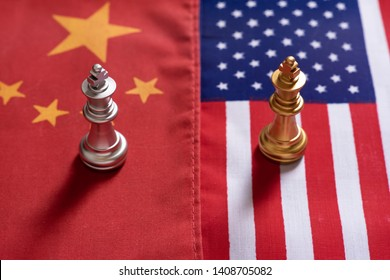 Chess game, two king stand confront on China and US national flags. Trade war concept. Conflict between two big countries, USA and China concept. Copy space.