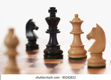 Chess game white queen challenging black king differential Focus