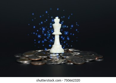 Chess king on coins. Business concept