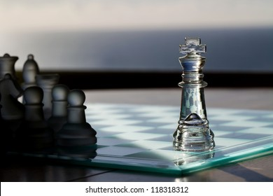 Chess King / Pieces - business concept series - advertising, marketing, sales, strategy, business leadership, mentor, business consultancy - business card. King in light, other chess pieces in shadow.