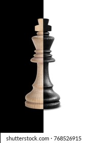 Chess king showing its duality in black and white background