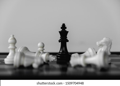 Chess King stand as last winner, victory over the enemies. The winner in business competition. Competitiveness and strategy.