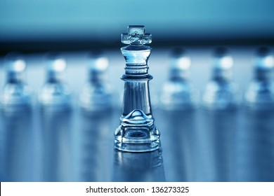 Chess King (with pawns out of focus) - business concept for leadership, strategy, CEO, consulting, mentoring and business advice - authoritative business card design with copy space.