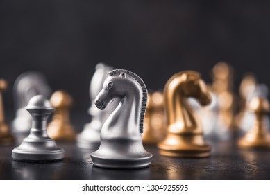 chess knight horse on the chessboard, stone background. selective focus.