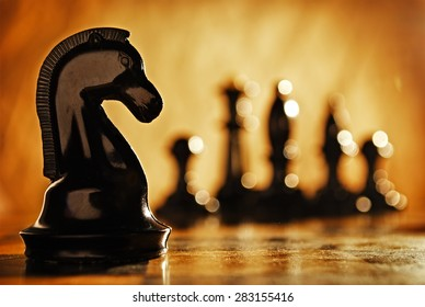 Chess knight chess pieces in front and in the background. The idea of winning and strategies.