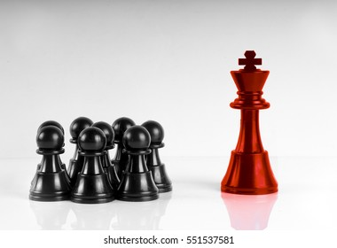 Chess leadership concept with red and black chess isolated in white background