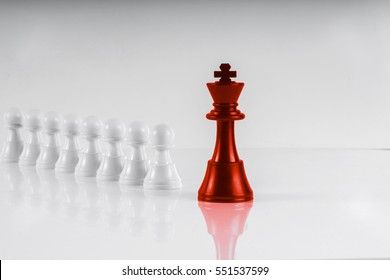 Chess leadership concept with red and white chess isolated in white background