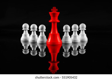 Chess leadership concept with red and white chess isolated in black background