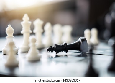 Chess leadership and success concept, chess save the strategy and king on chess board.