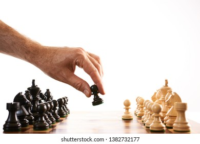 Chess make the first move man moves piece on chessboard