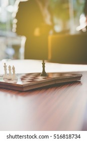 chess in office with background of businessman - business concept