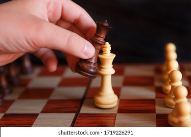 chess on a chessboard on a black background