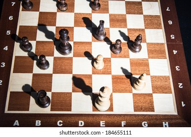 Chess on chessboard. Top view