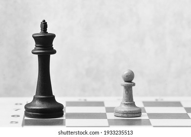 chess on a chessboard - white pawn in front of the black king - black and white