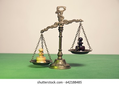 Chess pawn on justice scale, business concept, legal concept, bad vs good.