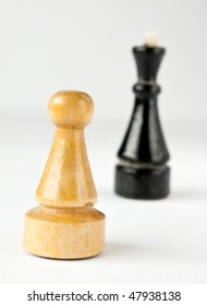 Chess pawns over white background