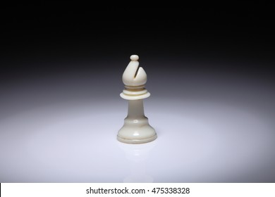 chess piece bishop on the white background with spot light