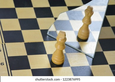 A chess piece stands in front of a mirror and sees itself in another body or in another form - a concept for transvestites who feel uncomfortable in their bodies and are different in their hearts
