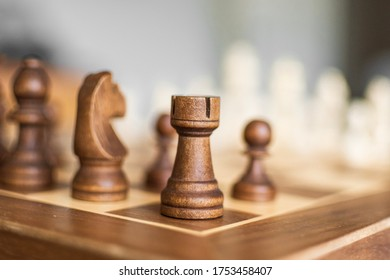 Chess Pieces from behind, Before the game starts. Board Game, Wood pieces. Brown Side
