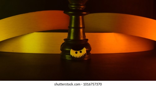 Chess pieces with a button unique object stock photograph