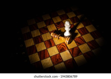 chess pieces in a dark room with an emphasis of light on certain places and subjects chess queen's move checkmate victory defeat macro shooting of chess victory in the game
