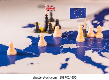 Chess pieces and flags on an European map focused on white EU king. Brexit negociations and strategy concept between European Union and United Kingdom.
