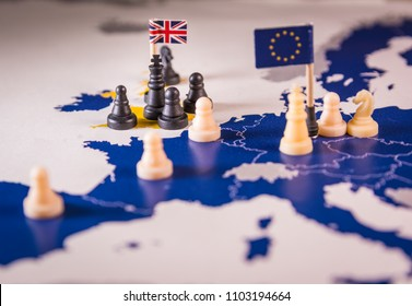Chess pieces and flags on an European map focused black UK king. Brexit negociations and strategy concept between European Union and United Kingdom.