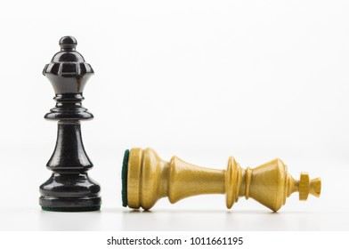 Chess pieces in front of white background