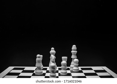Chess pieces on the board with black background